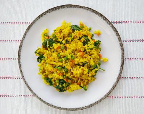 arroz integral con espinacas y guisantes